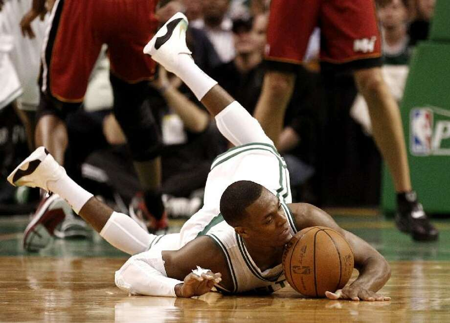 ASSOCIATED PRESS Boston's Rajon Rondo hits the floor after being tripped during the first quarter of Game 3 of a second-round NBA playoff series against the Miami Heat in Boston Saturday. Rondo returned to the floor in the fourth quarter after dislocating his elbow. The Celtics won 97-81.