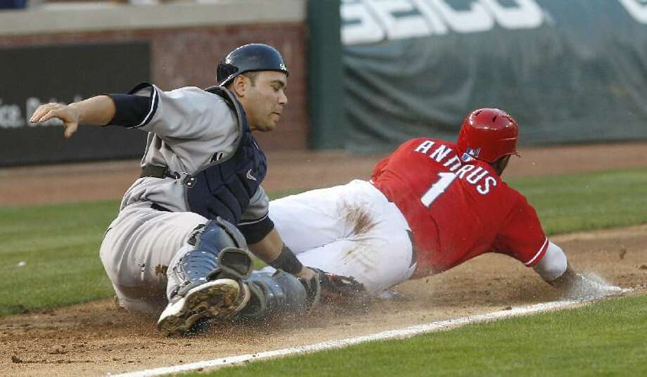 ASSOCIATED PRESS New York Yankees catcher Russell Martin puts the tag on Texas Rangers shortstop Elvis Andrus (1), catching him off third base for the out during the second inning of Saturday's game in Arlington. The Yankees lost 7-5.