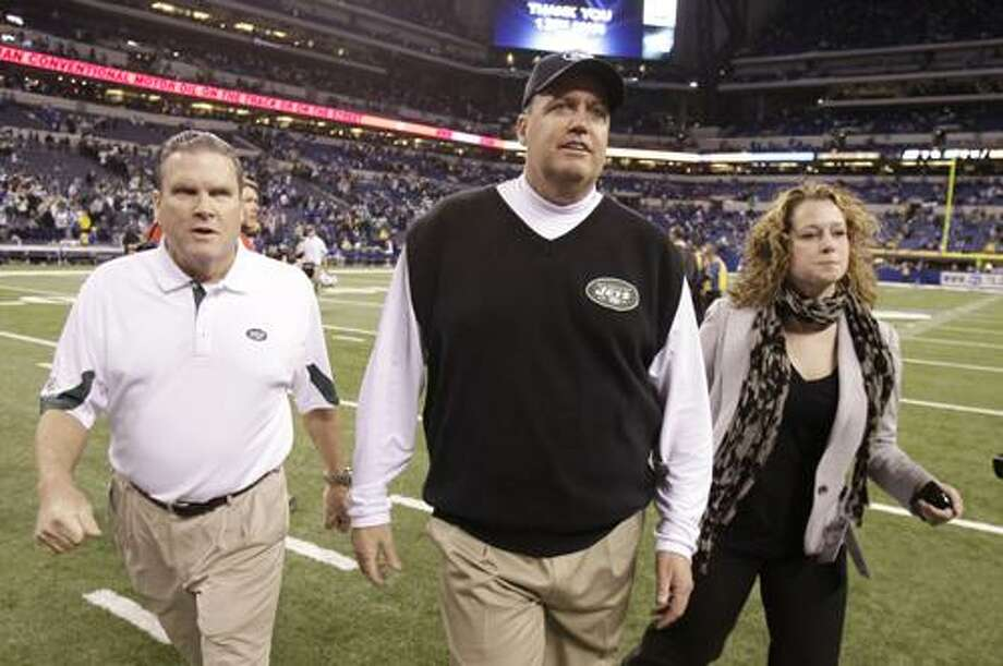 New York Jets head coach Rex Ryan, middle walks off the field after New York defeated the Indianapolis Colts, 17-16, in an NFL AFC wild card football playoff game in Indianapolis, Saturday, Jan. 8, 2011. (AP Photo/Michael Conroy) Photo: ASSOCIATED PRESS / AP2011