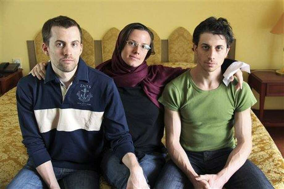 FILE - In this May 20, 2010 file photo, American hikers Shane Bauer, left, Sarah Shourd, center, and Josh Fattal, sit at the Esteghlal Hotel in Tehran, Iran. Iran announced Thursday that one of the three Americans jailed for more than a year will be released Saturday to mark the end of Islamic holy month of Ramadan. (AP Photo/Press TV, File) Photo: AP / AP2010