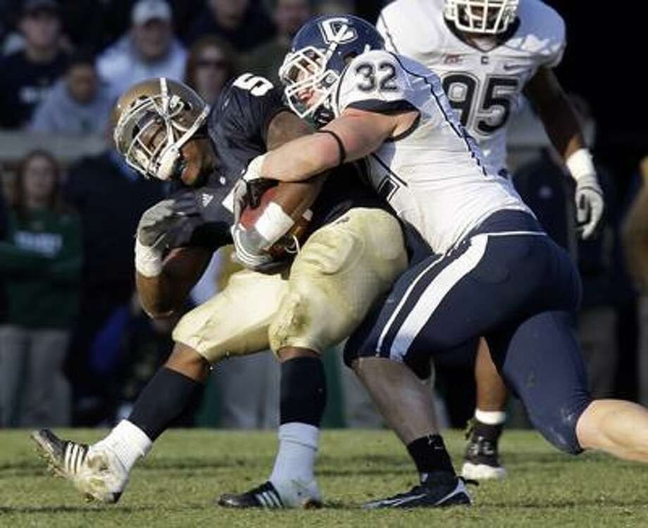 Notre Dame running back Armando Allen Jr. is tackled by Connecticut linebacker Scott Lutrus during the first quarter of an NCAA college football game in South Bend, Ind., Saturday, Nov. 21, 2009. (AP) Photo: ASSOCIATED PRESS / AP2009