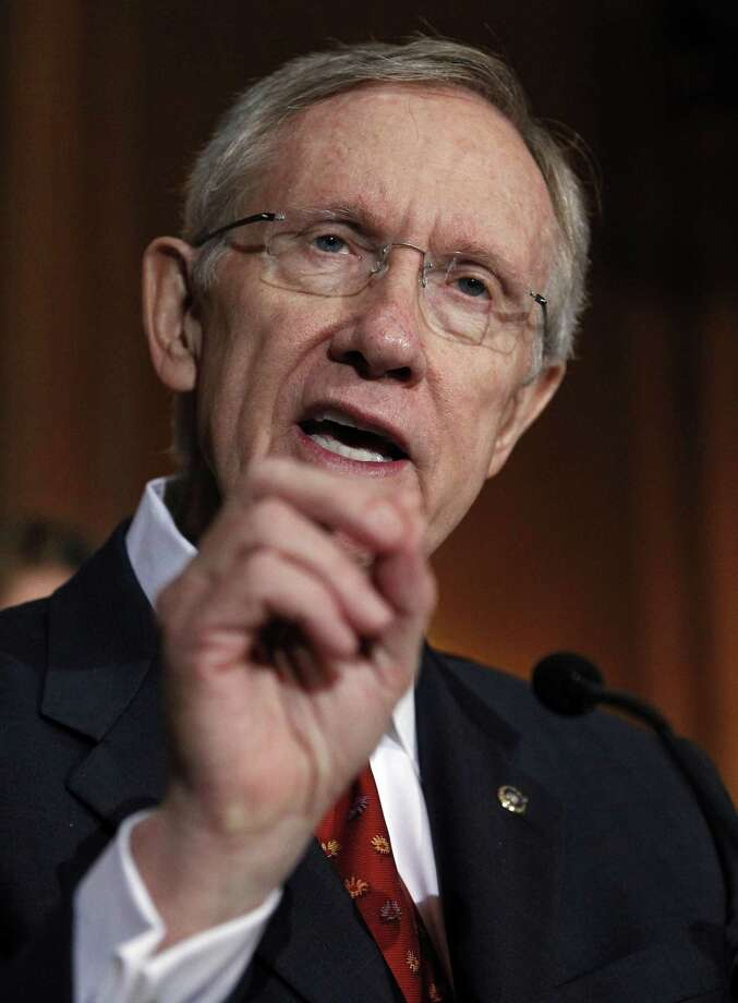 "In this Aug. 5, 2010 file photo, Senate Majority Leader Harry Reid of Nev. gestures during a news conference on Capitol Hill in Washington. ""It's still the economy, stupid."" And there's virtually nothing Democrats can do to change that reality before Nov. 2. Time has all but run out for President Barack Obama and his party, which had hoped for a big economic turnaround by the homestretch of the midterm elections. (AP Photo/Alex Brandon, File) Photo: AP / AP"