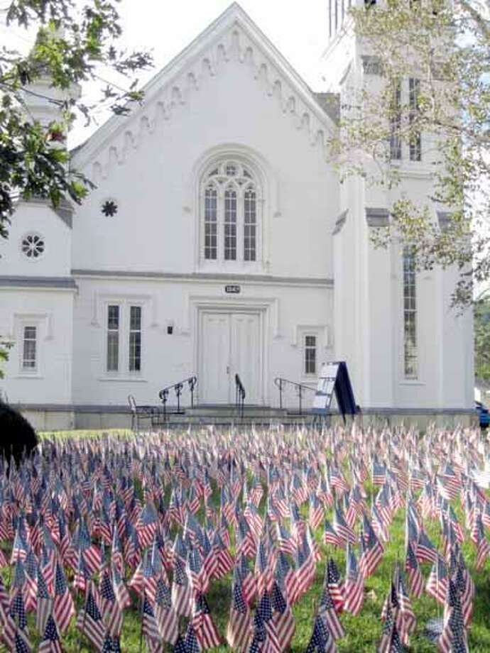 """Over 5,600 flags rest in front of the First Congregational Church of Kent as a part of the """"Field of Flags"""" display founded in Somers, Conn. as a way to recognize fallen soldiers. JESSIE SAWYER/Journal Register News"""