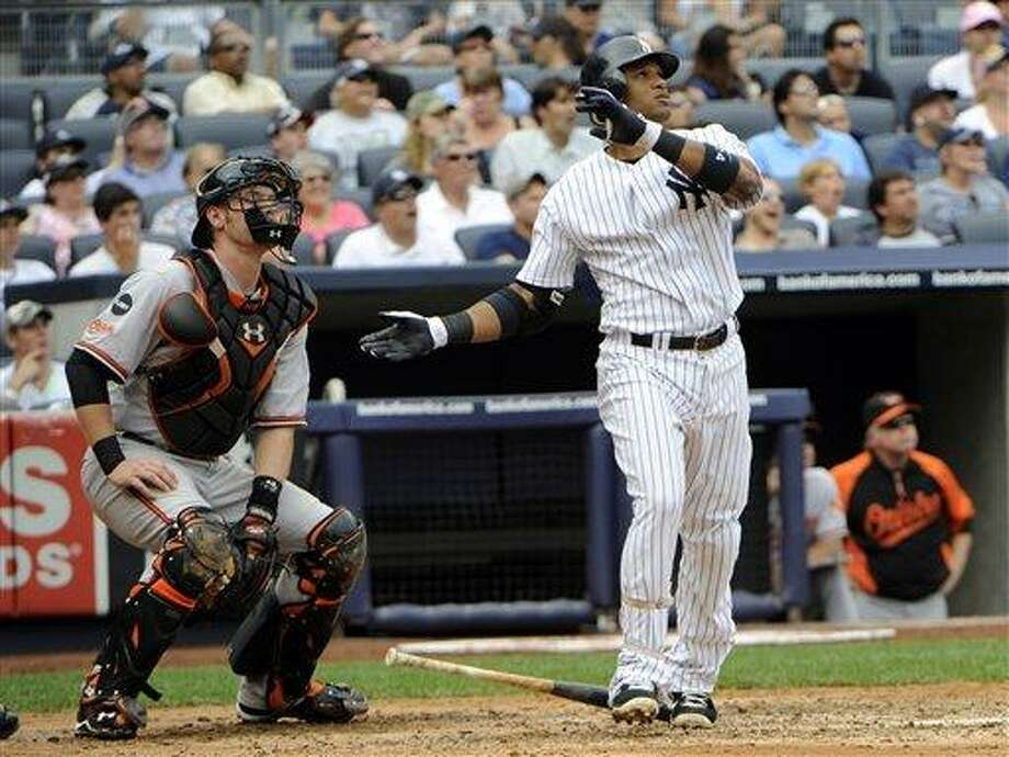 New York Yankees' Robinson Cano watches his grand-slam as Baltimore Orioles catcher Matt Wieters, left, looks on during the second inning of a baseball game Monday, Sept. 5, 2011, at Yankee Stadium in New York. (AP Photo/Bill Kostroun) Photo: AP / FR51951 AP