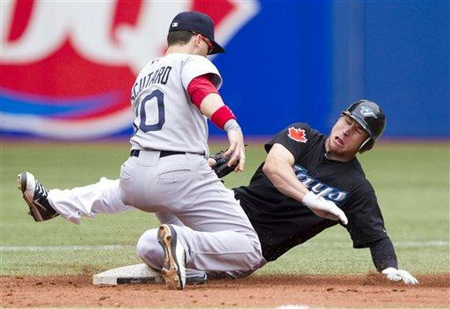 Toronto Blue Jays' Brett Lawrie, right, slides in to steal second under the tag of Boston Red Sox's Marco Scutaro during the second inning of a baseball game in Toronto Monday, Sept. 5, 2011. The Blue Jays defeated the Red Sox 1-0. (AP Photo/The Canadian Press, Darren Calabrese) Photo: AP / The Canadian Press