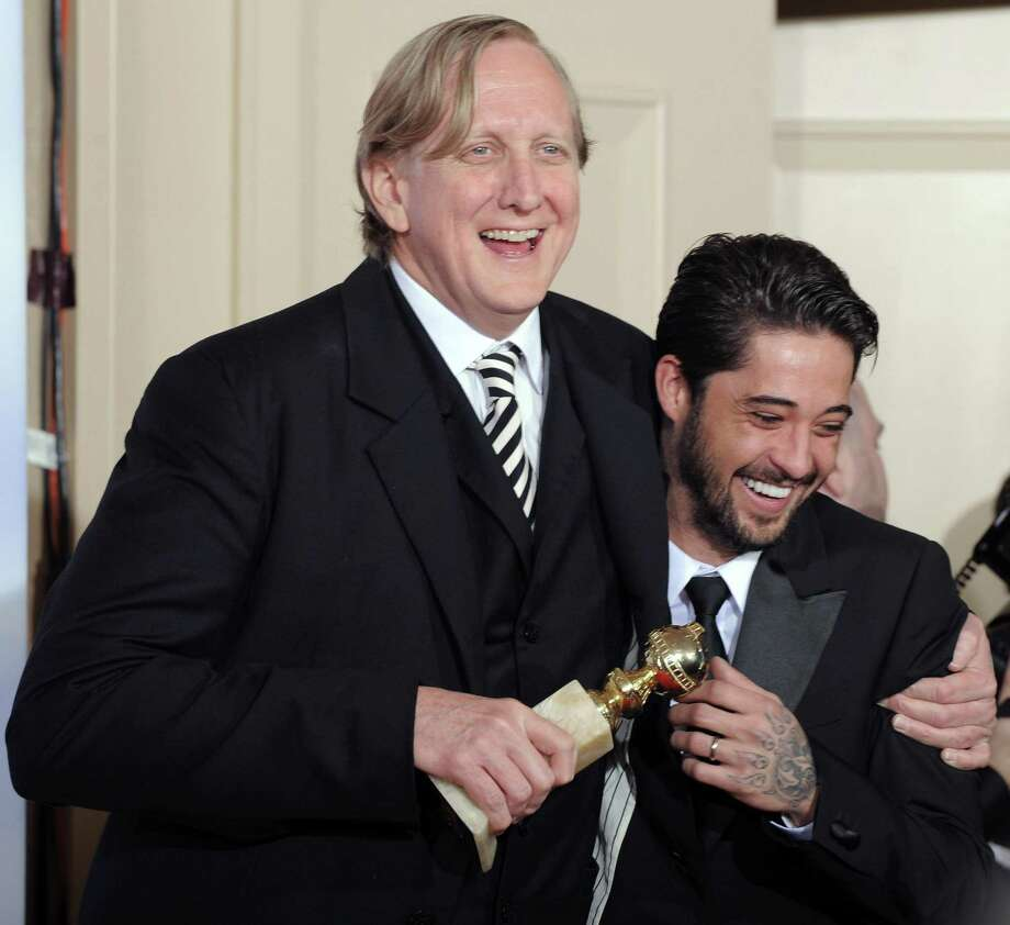 """In this Jan. 17, 2010 file photo, T Bone Burnett, left, and Ryan Bingham are photographed with the award for best original song in a motion picture for """"Crazy Heart"""" backstage at the 67th Annual Golden Globe Awards in Beverly Hills, Calif. (AP) Photo: AP / AP2010"""