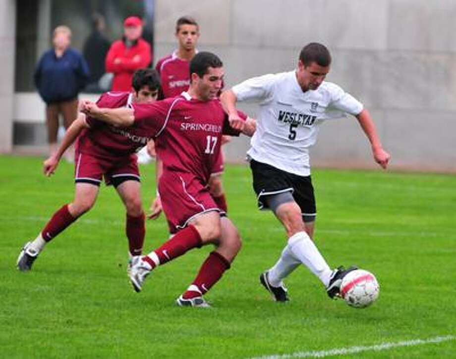 Wesleyan's men's soccer player, Geoff Zartarian (5), gains possession of the ball against Springfield College last season. Zartarian is a tri-captain for the 2010 Cardinals. (Photo courtesy of Peter Stein