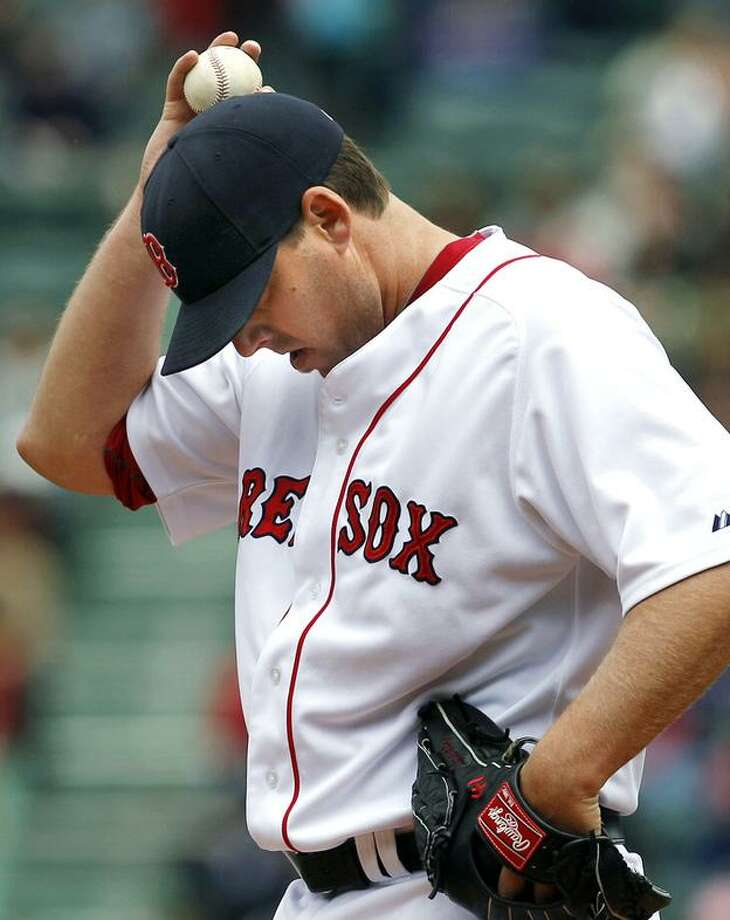 Boston Red Sox starting pitcher John Lackey reacts on the mound against the Los Angeles Angels during the first inning of a baseball game at Fenway Park in Boston, Thursday, May 5, 2011. The Angels won 11-0. (AP Photo/Elise Amendola) Photo: ASSOCIATED PRESS / AP2011