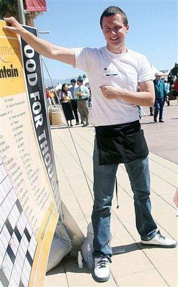 This March 2010 photo shows a man identified as Jared L. Loughner at the 2010 Tucson Festival of Books in Tucson, Ariz. The Arizona Daily Star, a festival sponsor, confirmed from their records that the subject's address matches one under investigation by police after a shooting in Tucson that left U.S. Rep. Gabrielle Giffords wounded and at least five others dead. Police say a suspect is in custody, and he was identified by people familiar with the investigation as Jared Loughner, 22, of Tucson.  (AP Photo/Arizona Daily Star, Mamta Popat) NO MAGS, NO SALES, MANDATORY CREDIT Photo: AP / Arizona Daily Star