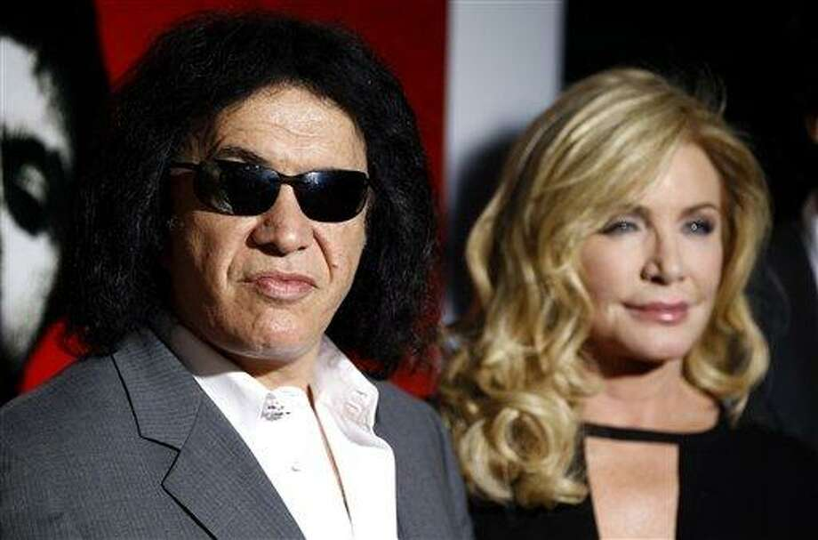"In this Aug. 23, 2011 file photo, Gene Simmons, left, and Shannon Tweed arrive at the ""Scarface"" Legacy Celebration Event in Los Angeles. A publicists says Friday, Sept. 2, 2011, that  the couple is engaged and will be getting married in the near future. (AP Photo/Matt Sayles, file) Photo: AP / AP2011"