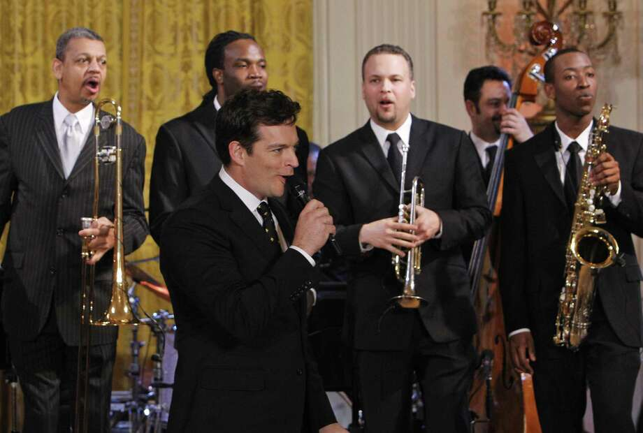 Harry Connick Jr., sings during a special preview for local music students, of the talent performing at the White House annual Governors Ball, at the White House in Washington Sunday, Feb. 21, 2010. Behind him are Lucien Barbarin, left, Shamarr Allen, Mark Braud, Neal Caine on bass, and Calvin Johnson Jr., far right.(Associated Press) Photo: AP / AP