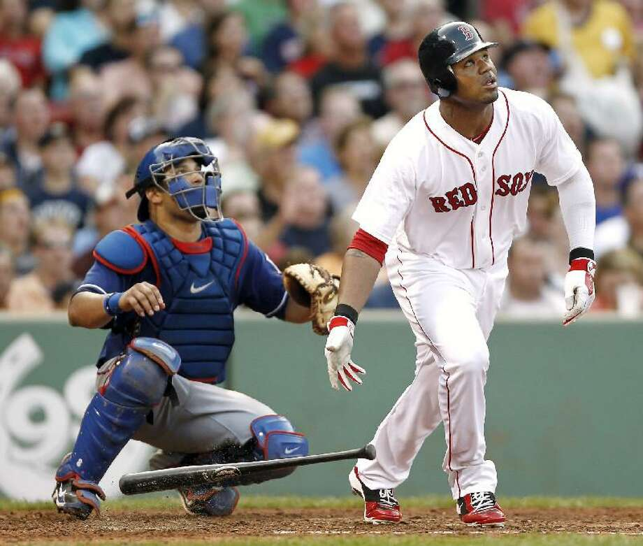 ASSOCIATED PRESS Boston Red Sox left fielder Carl Crawford, right, and Texas Rangers catcher Yorvit Torrealba watch Crawford's grand slam during the fourth inning of Saturday's game at Fenway Park in Boston.