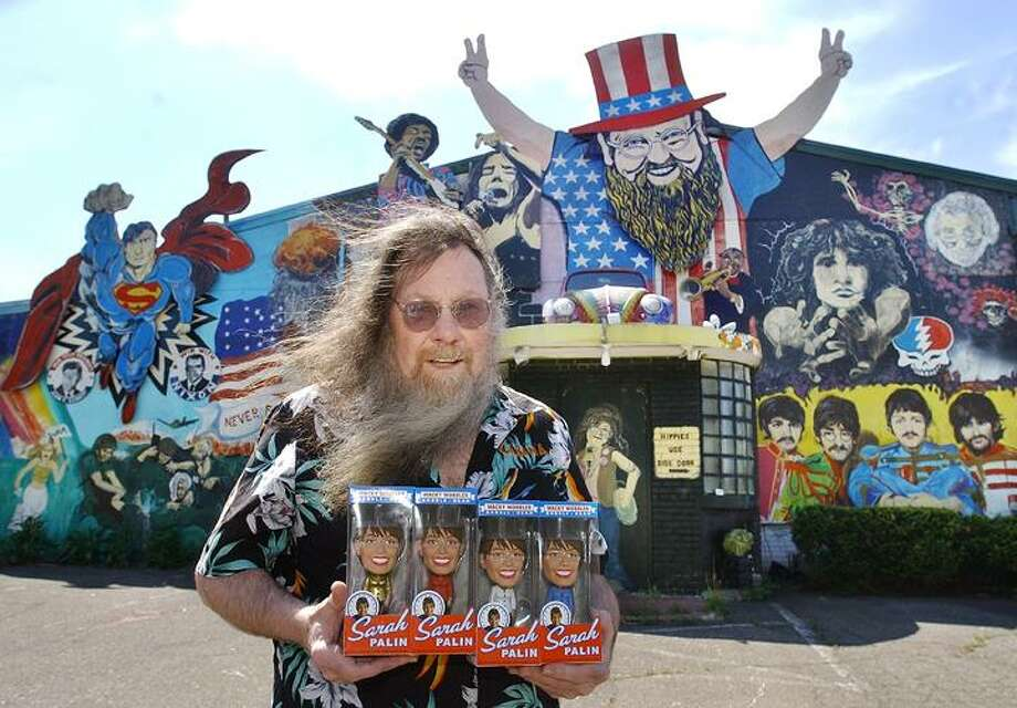 Bill Ziegler, proprieter of Wild Bill's on Newfield Street in Middletown, displays the Wacky Wobbler Sarah Palin Bobble Head dolls manufactured by the Funko Company. Ziegler said the 320 Limited Edition Gold Bobble Heads sell for $25. and the Red, White and Blue dolls sell for $15. (Catherine Avalone