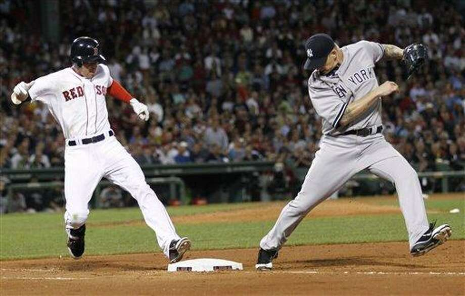 New York Yankees starting pitcher A.J. Burnett misses the bag as Boston Red Sox's Jacoby Ellsbury is safe on an infield hit during the fifth inning of a baseball game at Fenway Park in Boston pm Thursday, Sept. 1, 2011. (AP Photo/Winslow Townson) Photo: AP / FR170221 AP
