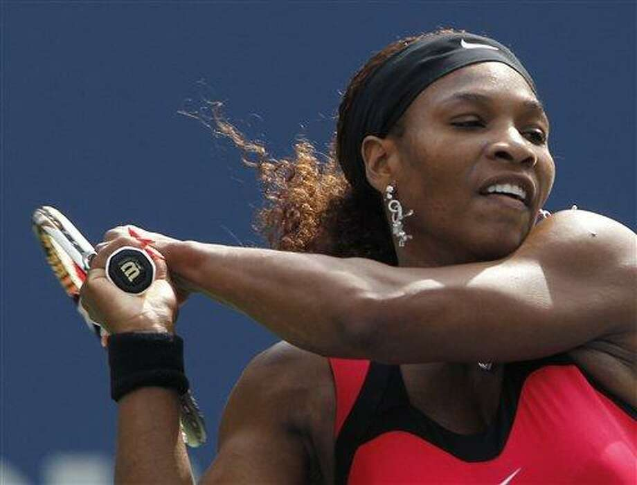 Serena Williams returns a shot to MichaellaKrajicek of the Netherlands during the U.S. Open tennis tournament in New York, Thursday, Sept. 1, 2011. (AP Photo/Mike Groll) Photo: AP / AP