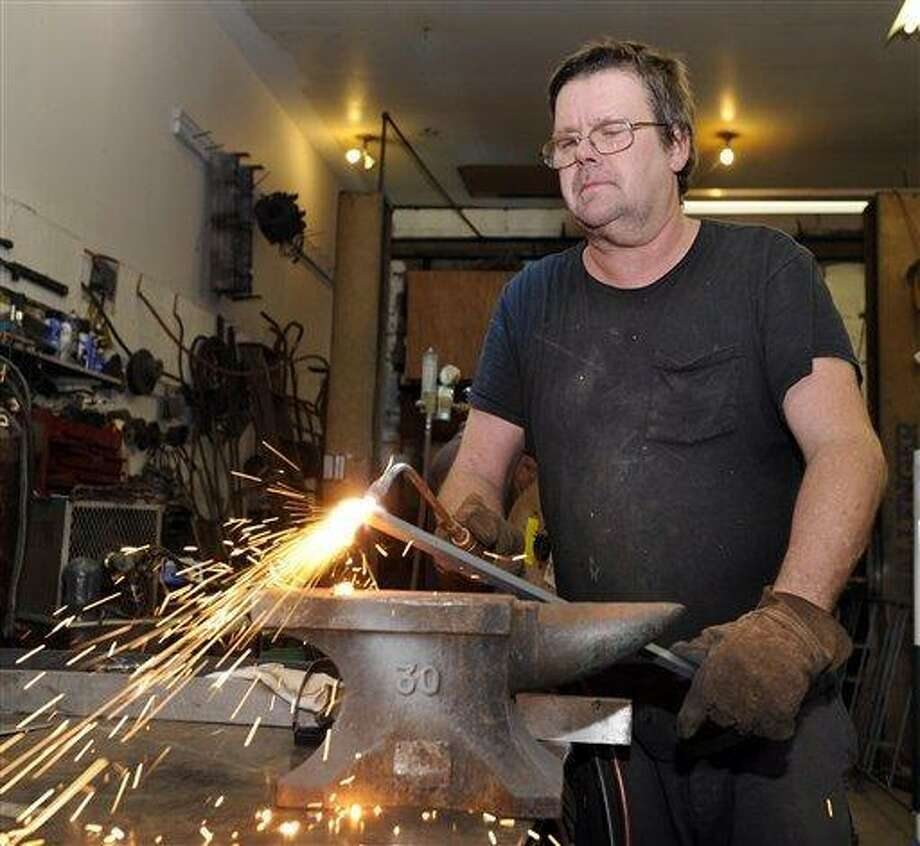 "In this Aug. 24, 2010 photo, million-dollar lottery winner Alfred ""Skip"" Consavage, 52, of Ridgefield, works in his shop, A.C. Skip's Welding in Norwalk, Conn., after taking a day off to celebrate winning $1 million in the state's Powerball drawing. (AP Photo/The News-Times, Carol Kaliff) Photo: AP / The News-Times"