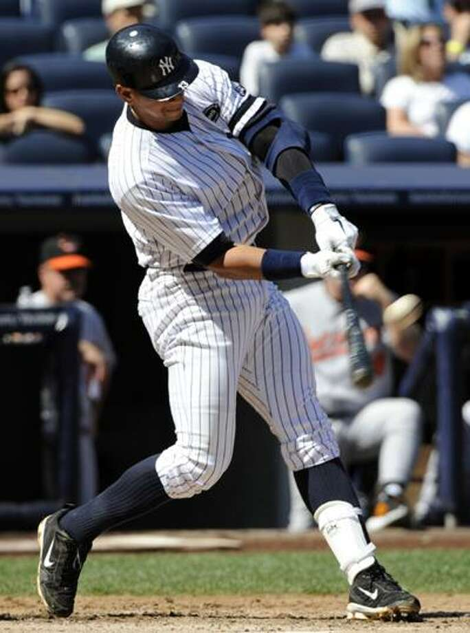 New York Yankees' Alex Rodriguez hits a home run during the fourth inning of a baseball game against the Baltimore Orioles Monday. (AP) Photo: ASSOCIATED PRESS / FR51951 AP