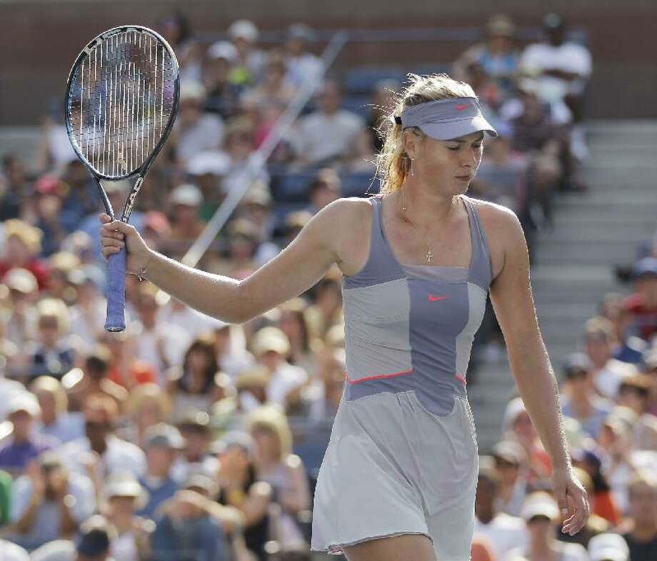 ASSOCIATED PRESS Maria Sharapova of Russia reacts during her match against Flavia Pennetta of Italy during the U.S. Open tennis tournament in New York, Friday.