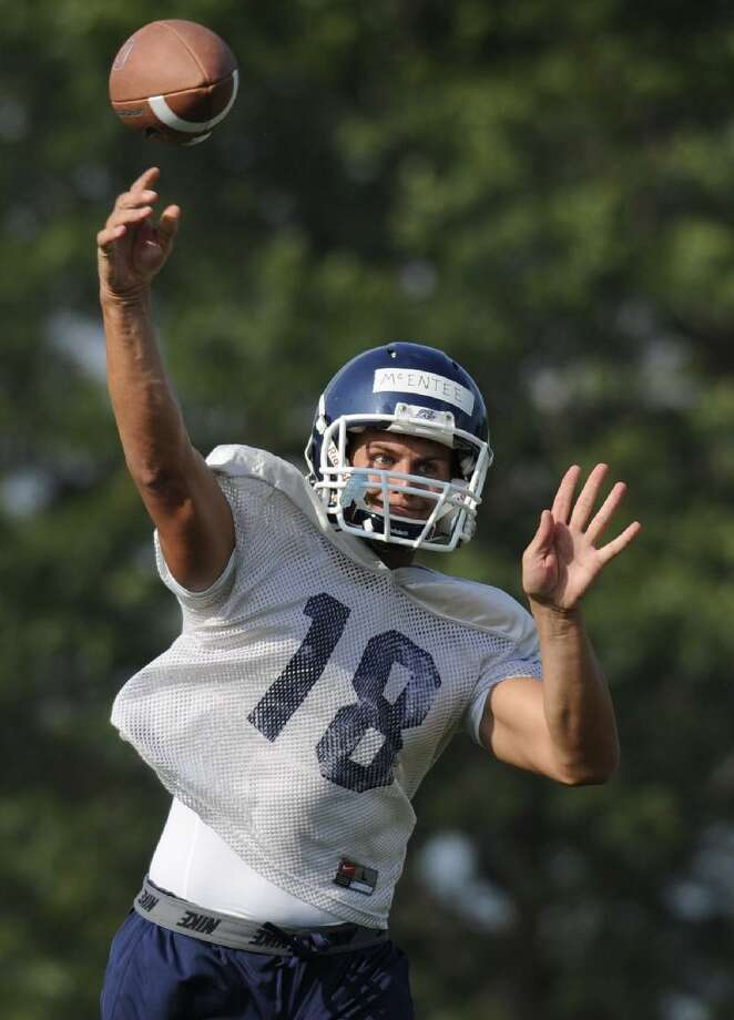 ASSOCIATED PRESS In this Aug. 5 file photo, Connecticut quarterback Johnny McEntee throws during the first practice of the season at the University of Connecticut in Storrs. McEntee is expected see time at quarterback Saturday when UConn opens the season against Fordham at Rentschler Field in East Hartford.