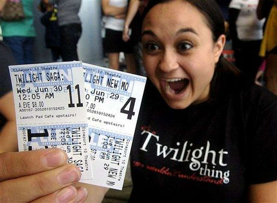 """After buying tickets for the two Twilight series movies about 1 1/2 months ago, Alice Griffin, 23, of Las Cruces becomes excited Tuesday, June 29, 2010, at the Cineport 10 in Las Cruces, N.M., upon realizing she will be seeing the third movie, """"The Twilight Saga: Eclipse,"""" premiering at midnight. """"The love story's amazing; absolutely breathtaking; nothing compares,"""" she said as to why she arrived at 3 p.m. to wait in line. The theater was having a special triple feature by showing first two movies in the Twilight series before the premiere of the third Twilight movie.   (AP Photo/Las Cruces Sun-News, Norm Dettlaff) Photo: AP / Las Cruces Sun-News"""
