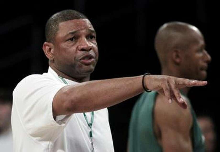 Boston Celtics coach Doc Rivers, left, gestures during basketball practice in Los Angeles, June 2. (AP) Photo: ASSOCIATED PRESS / AP2010