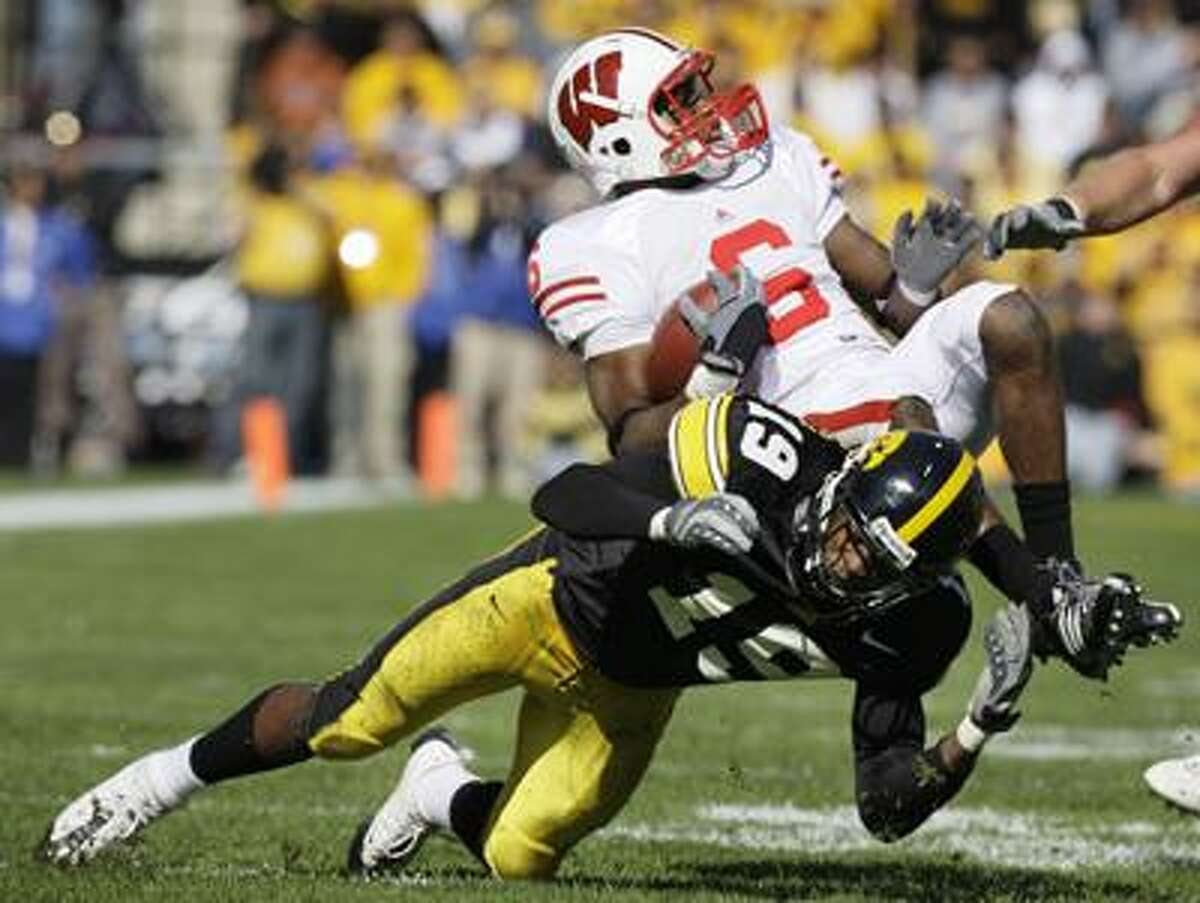 Wisconsin's Isaac Anderson (6) is upended by Iowa's Amari Spievey (19) after catching a pass during the second half of an NCAA college football game, Saturday, Oct. 18, 2008, in Iowa City, Iowa. (AP)