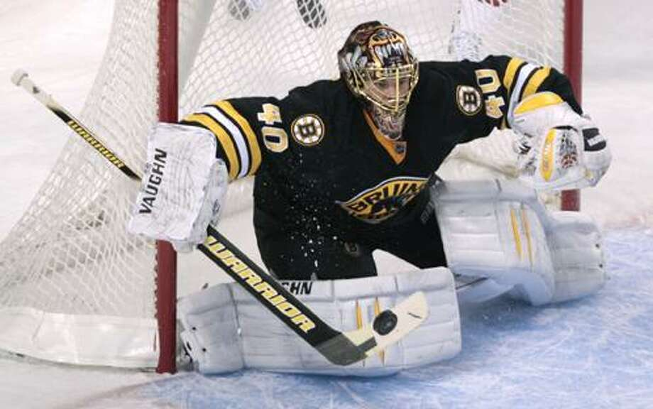Boston Bruins goalie Tuukka Rask, of Finland, makes a stick save against the Minnesota Wild during the first period of an NHL hockey game in Boston, Thursday, Jan. 6, 2011. (AP Photo/Charles Krupa)