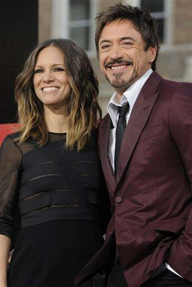 """In a May 19, 2011 file photo, actor Robert Downey Jr and his wife Susan pose together at the premiere of the film """"The Hangover Part II"""" in Los Angeles. Downey Jr. and his wife, Susan, are expecting their first child together. A representative for the 46-year-old actor confirmed a report Wednesday, Aug. 31, 2011 on People magazine's website. The baby is due early next year. (AP Photo/Chris Pizzello, File) Photo: AP / AP2011"""