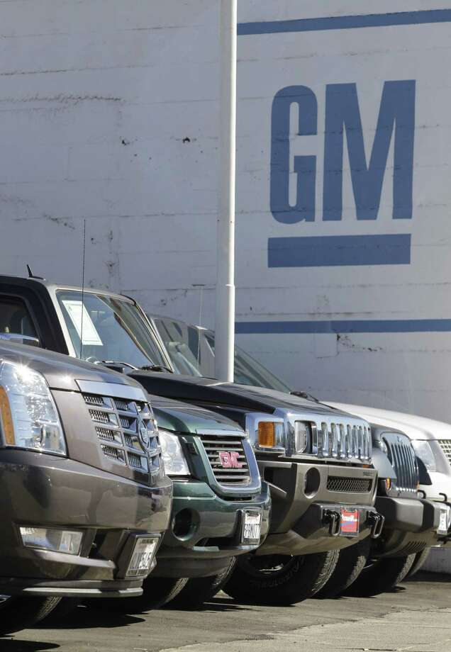 General Motors vehicles sit for sale at a dealership in Burlingame, Calif. General Motors says sales of cars and trucks in the U.S. rose 6.3 percent last year as a strong line-up of new models helped the company make a comeback from its 2009 bankruptcy. GM says it sold 2.2 million cars and trucks, even though it got rid of four brands to focus on Chevrolet, Buick, Cadillac and GMC. (AP Photo/Paul Sakuma) Photo: AP / AP