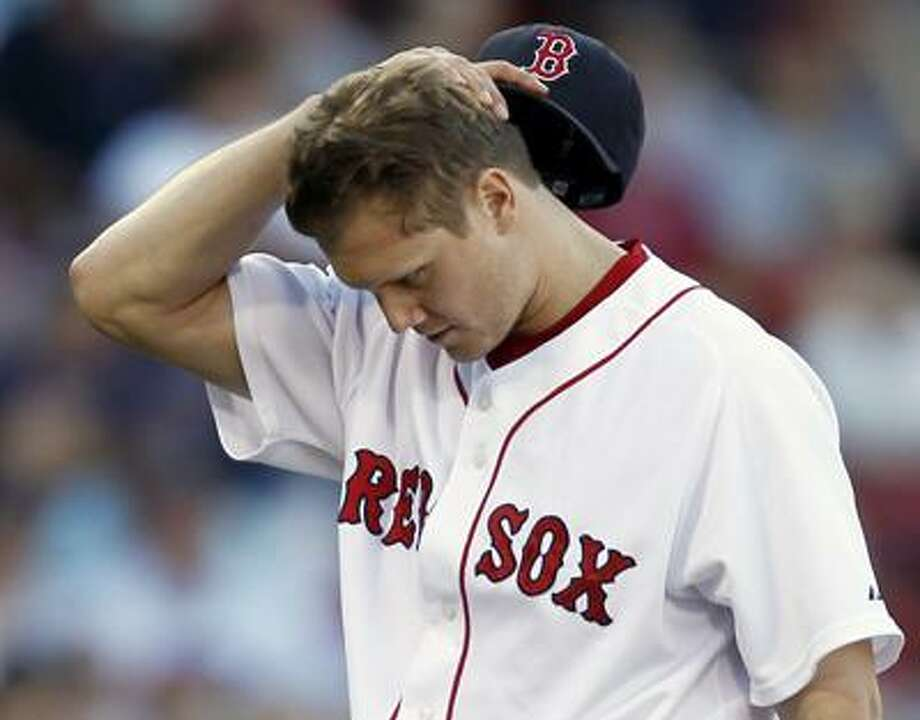 Boston Red Sox relief pitcher Jonathan Papelbon walks off the mound after giving up the tying run to the Chicago White Sox during the ninth inning of Chicago's 7-5 win in a baseball game at Fenway Park in Boston Sunday. (AP) Photo: ASSOCIATED PRESS / FR170221 AP