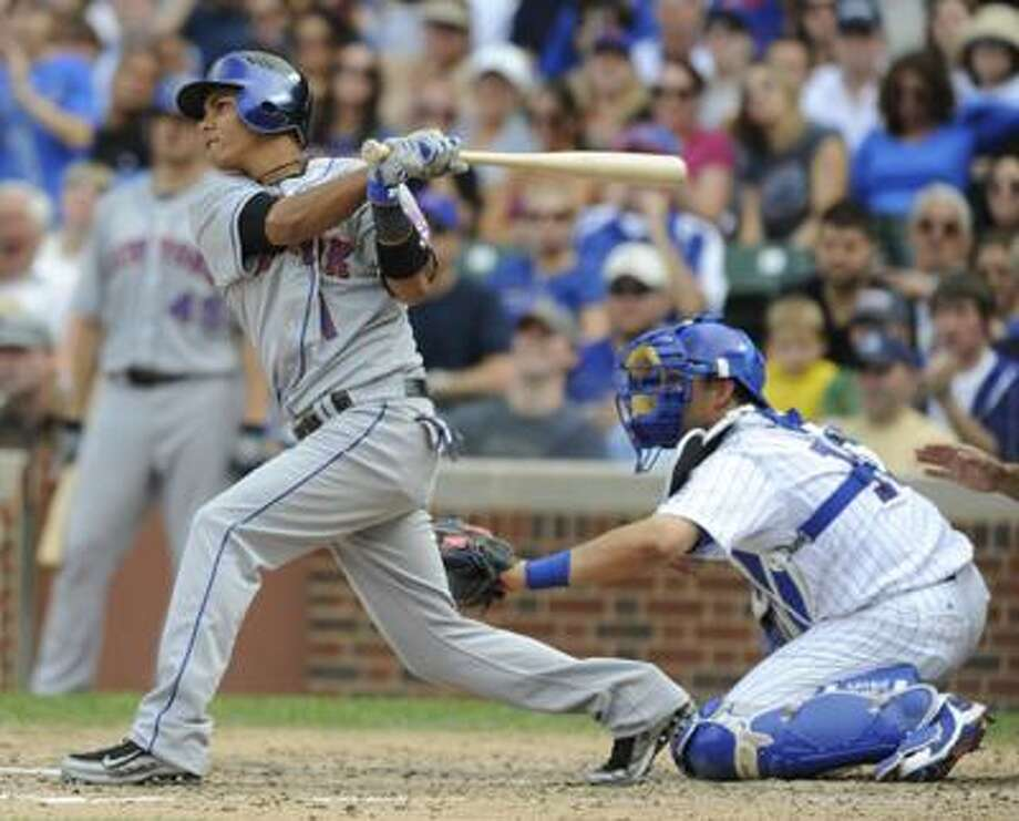 New York Mets Ruben Tejada hits a single driving in two runs against the Cubs in the sixth inning Sunday. (AP) Photo: ASSOCIATED PRESS / FR165605 AP