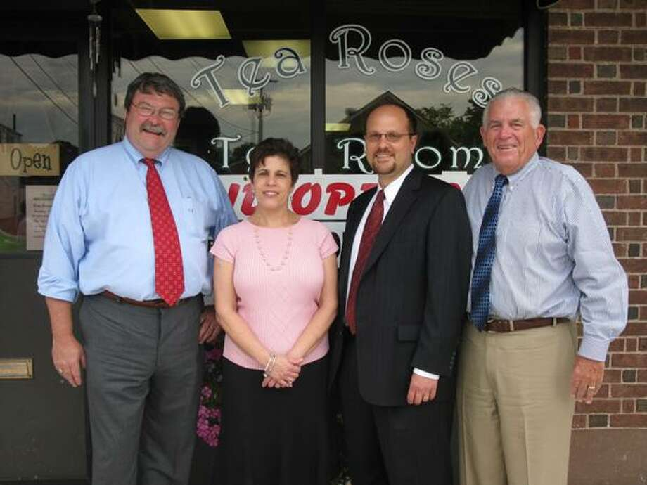 From left to right, Cromwell First Selectman John Flanders, Tea Roses Tea Room owner Peggi Camosci, Middlesex Chamber Cromwell Division chairman Michael Camilleri and chamber president Larry McHugh are pictured at Tea Roses Tea Room's grand opening event on June 22 in Cromwell.