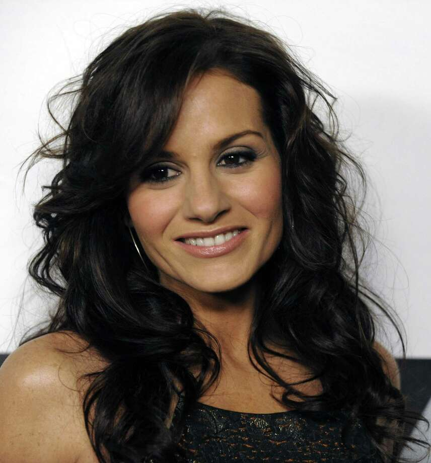 "In this Jan. 13, 2009 file photo, Kara DioGuardi of ""American Idol"" arrives at the FOX Winter All-Star Party in Los Angeles. Fox TV says Kara DioGuardi is leaving as `American Idol' judge, Friday. (AP Photo/Chris Pizzello, file) Photo: ASSOCIATED PRESS / AP"