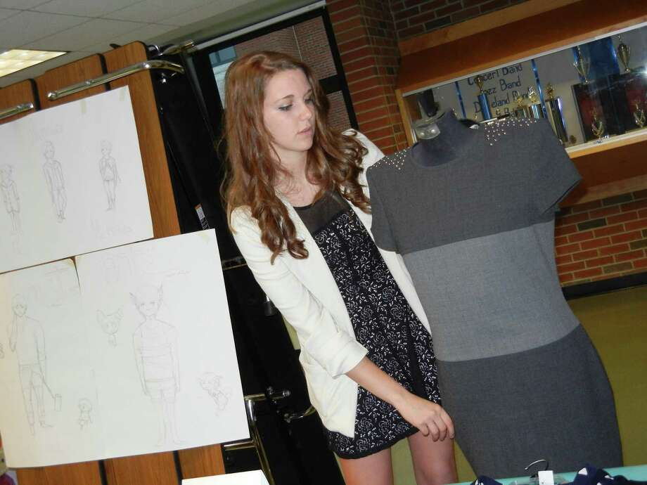 Submitted photos Carleen Doyle, a senior, displayed her WISE project on refurbished dresses  at the Senior Arts Showcase. Doyle plans to study Fashion Merchandising with a specialization in Styling at LIM College in New York in the fall.