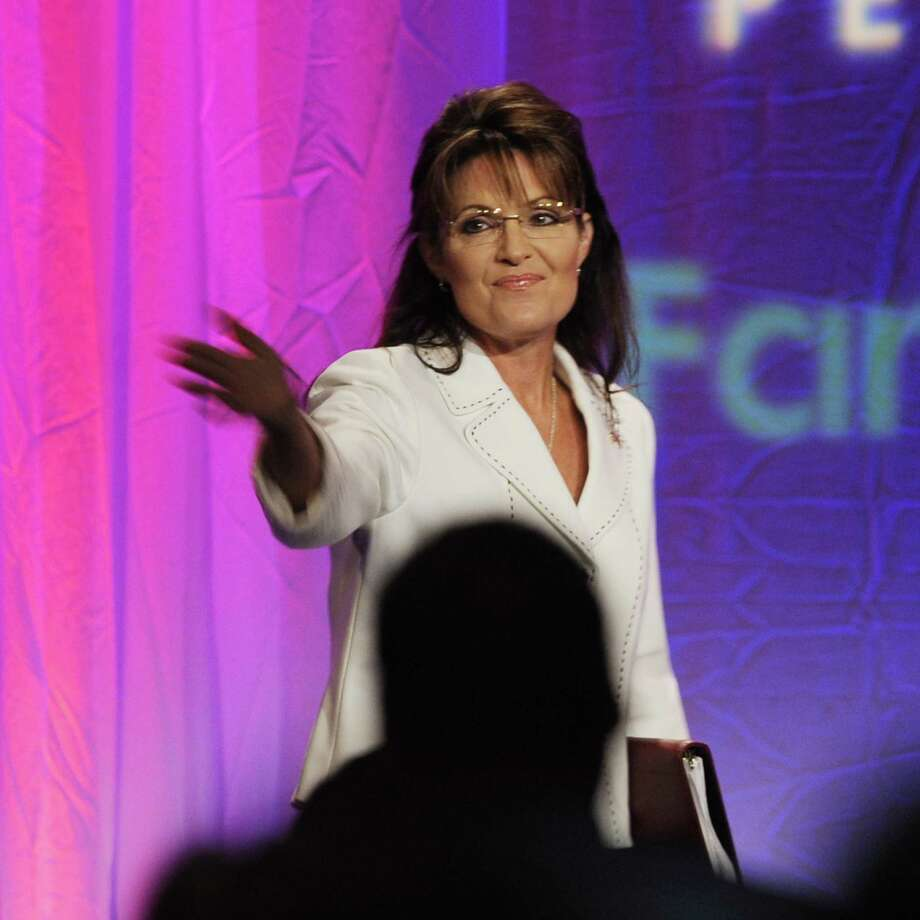 Former vice presidential candidate Sarah Palin acknowledges members of  the Pennsylvania Family Institute as she walks on stage to give a speech Friday, Aug. 27, 2010 in Hershey, Pa. (AP Photo/Bradley C Bower) Photo: ASSOCIATED PRESS / FR37962 AP