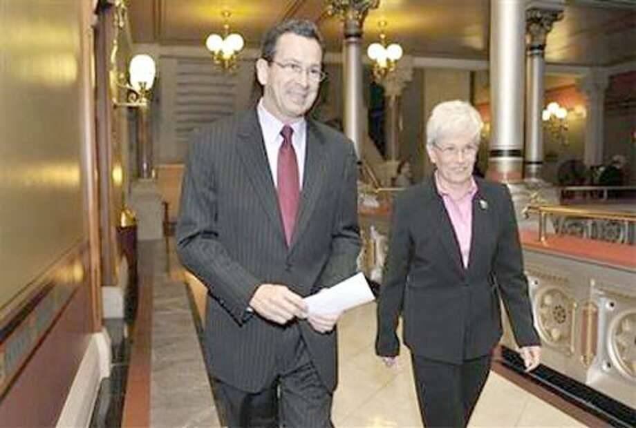 Governor- Elect Dan Malloy is seen with running mate Nancy Wyman arrive for a news conference - Hartford, CT - Nov 8, 2010 - AP Photo/Jessica Hill