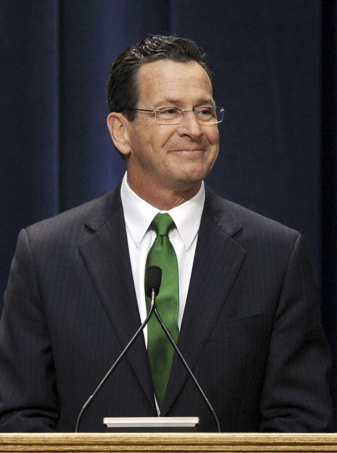 Gov. Dan Malloy smiles to the crowd after being sworn in as Connecticut's 88th governor inside the Hartford State Armory in Hartford Conn.,Wednesday.(AP Photo/Sean D. Elliot, Pool) Photo: AP / Pool, The Day