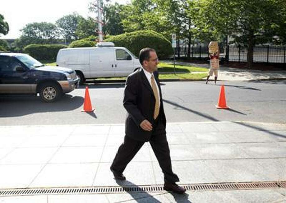 Hartford Mayor Eddie Perez enters Hartford Superior Court on June 18, 2010 on the second day of jury deliberations in his corruption trial in Hartford, Conn. A Connecticut jury has convicted Perez of corruption charges, including accepting home improvements as a bribe and trying to extort money from a real estate developer. (AP) Photo: ASSOCIATED PRESS / The Hartford Courant