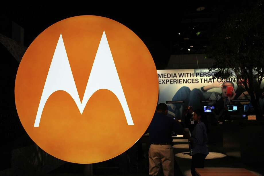 In this file photo, the Motorola logo is seen at the company's exhibit at the Consumer Electronics Show in Las Vegas. Motorola Inc.'s formal split into two companies on Tuesday will mark the final step in the years-long breakup of a consumer electronics industry pioneer. (AP Photo/Paul Sakuma, File) Photo: AP / AP2010