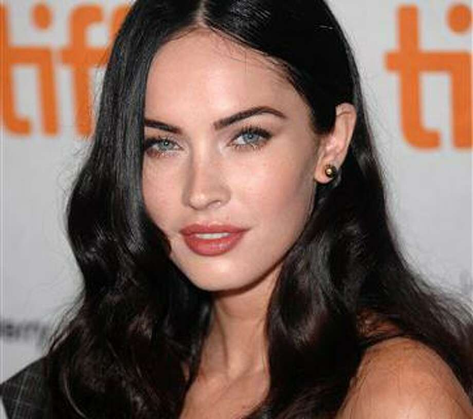 "FILE - In this Sept. 11, 2009 file photo, actress Megan Fox participates in a press conference for the film ""Jennifer's Body"" during the Toronto International Film Festival in Toronto. (AP Photo/Evan Agostini, file) Photo: ASSOCIATED PRESS / AGOEV"