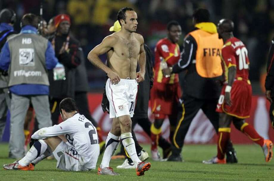 United States' Landon Donovan leaves the pitch after  the World Cup round of 16 soccer match between the United States and Ghana at Royal Bafokeng Stadium in Rustenburg, South Africa, Saturday, June 26. Ghana won 2-1 in extra time, advancing to the World Cup quarterfinals.(AP Photo/Matt Dunham) Photo: AP / AP