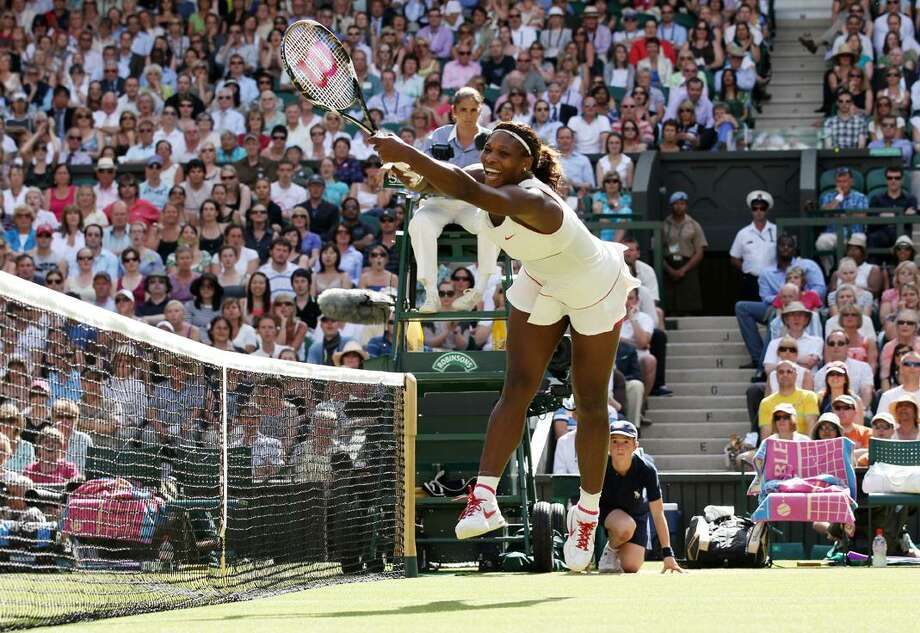 Serena Williams of the United States reaches for a backhand volley during her quarterfinal match against China's Li Na at the All England Lawn Tennis Championships at Wimbledon, Tuesday. (AP Photo/Anja Niedringhaus) Photo: AP / AP