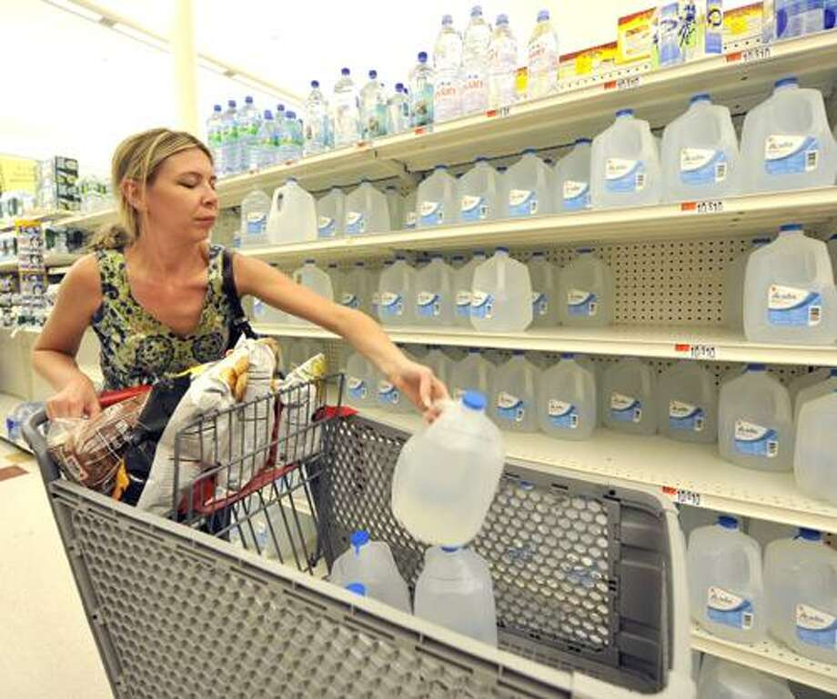 Kerry Hosek of Bay Shore stock up on water on Thursday, Sept. 2, 2010 in preparation for the arrival of Hurricane Earl, at the Super Stop & Shop on Montauk Highway in Bay Shore, N.Y. (AP Photo/Kathy Kmonicek) Photo: AP / FR170189 AP