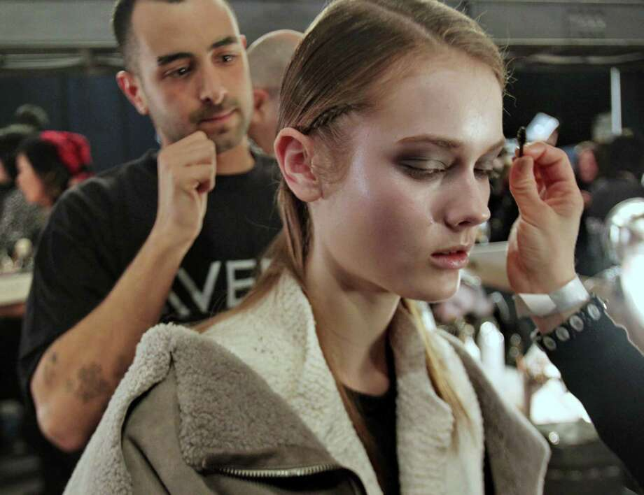 Stylists prepare model Jac backstage before she models in the Rodarte Fall 2010 collection, Tuesday, in New York. (Photo/Amina Bobb) Photo: AP