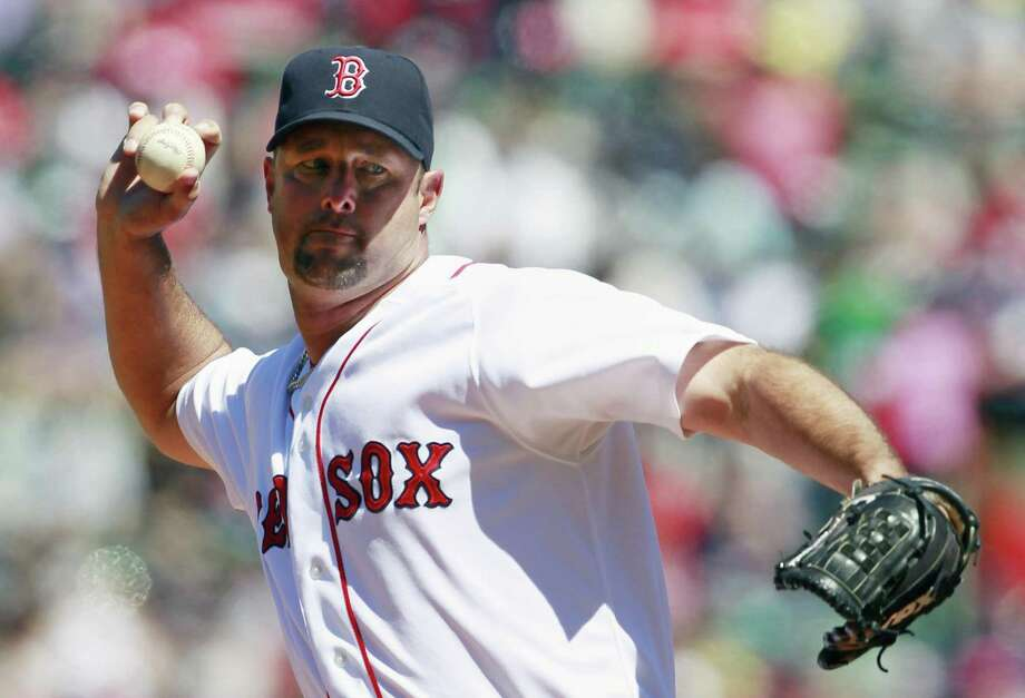 Boston Red Sox's Tim Wakefield pitches in the first inning of an MLB baseball game against the Seattle Mariners, Sunday, May 1, 2011, in Boston. (AP Photo/Michael Dwyer) Photo: ASSOCIATED PRESS / AP2011