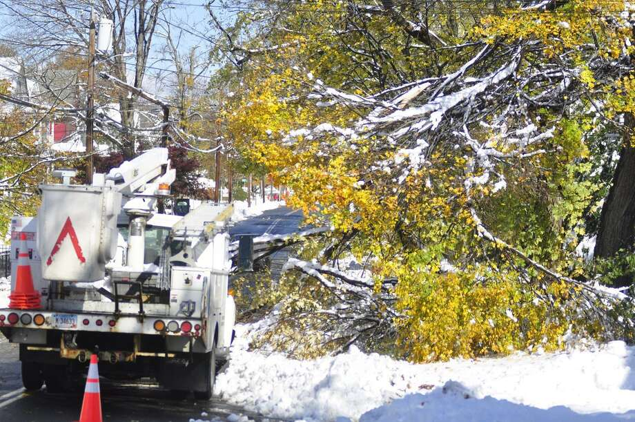 CL&P crews are on site throughout Torrington with their first order of business to clear downed power lines and trees that have collapsed them, or are in danger of collapsing lines. This truck sat on Prospect Street this morning.