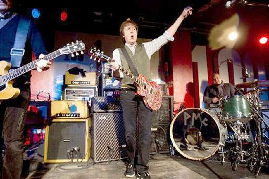 In this handout photo made available by MPL Communications Ltd on Friday, Dec. 17, 2010. British musician Sir Paul McCartney performs at the 100 Club in London. (AP Photo) Photo: ASSOCIATED PRESS / AP2010