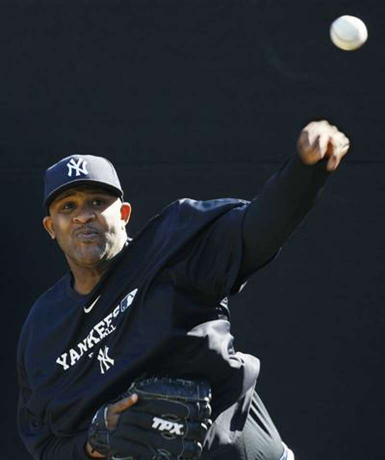 New York Yankees starting pitcher CC Sabathia throws in the bullpen on the first day of spring training at Steinbrenner Field in Tampa, Fla., Wednesday. (Associated Press) Photo: ASSOCIATED PRESS / AP2010