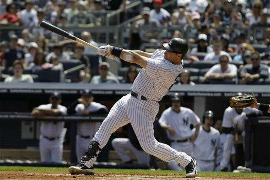 New York Yankees' Mark Teixeira follows through on a first-inning solo home run off Toronto Blue Jays starting pitcher Jesse Litsch during a baseball game in New York, Sunday, May 1, 2011. (AP Photo/Kathy Willens) Photo: AP / AP