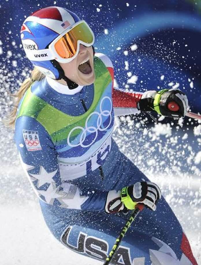 Lindsey Vonn reacts in the finish area after completing the Women's downhill at the Vancouver 2010 Olympics in Whistler, British Columbia, Wednesday. (Associated Press) Photo: AP / AP